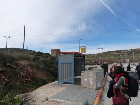 EAs pass the bus stop at Za'atar Junction. The manned guard tower overlooking the stop is visible in the background.
