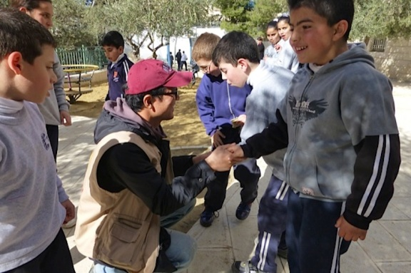 An EA from Korea shaking hands with students.