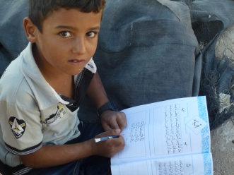 This boy in Masafer Yatta is eager to use his new school books. Photo EAPPI/A. Konnestad