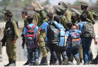 Near the Al Rajabi building in Hebron, soldiers constantly surround the children on their way to school. Everyday children are confronted with military and police. Photo EAPPI/R. Kolehmainen