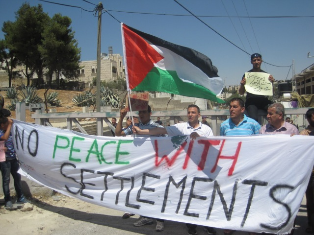 A demonstration in support of the Al Rajabi building. Photo EAPPI/S. Hefekaeuser.