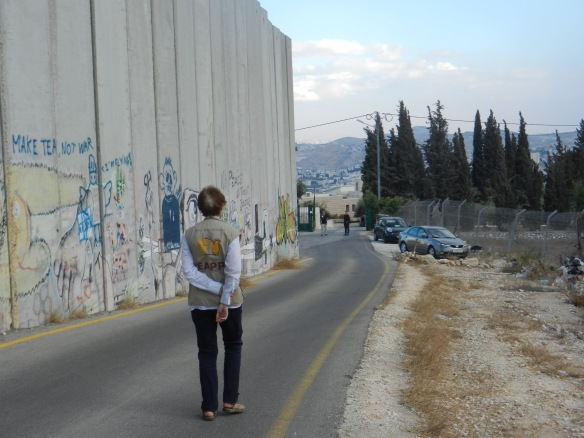 An EA walks near the separation wall in Bethlehem. Photo EAPPI/G. Galmen.