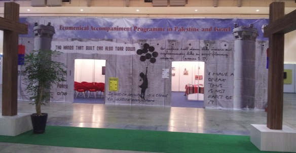 A banner of the separation wall hung over the entrance to EAPPI's booth at the WCC 10th General Assembly. Photo EAPPI.