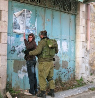 An Israeli soldier searches a 15 year old boy in Hebron.  One of the many incidents that takes place in Hebron that many Israelis don't know about. Photo EAPPI, August 2012.