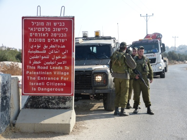 The Israeli forces set up concrete blocks and new warning signs. Photo EAPPI/A. Morgan.