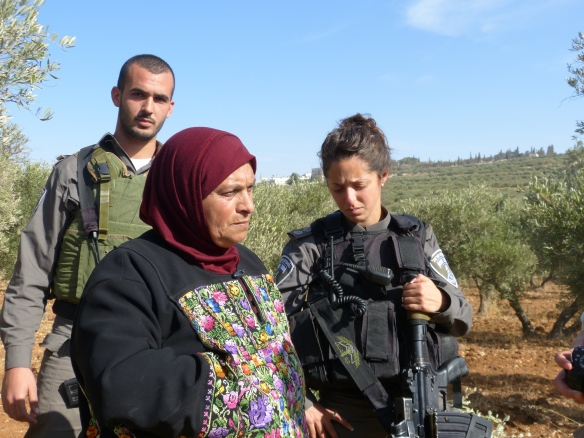 An Israeli soldier cries as a Palestinian woman pleas for her olive trees not to be destroyed. Photo EAPPI/A. Morgan.
