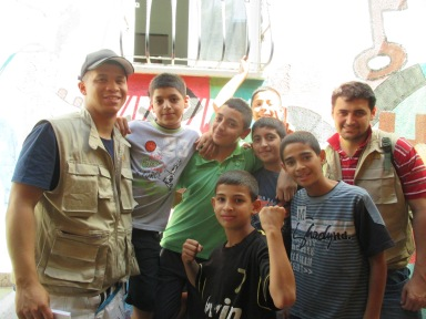 Former EAs with students in Wadi Hilweh. Photo EAPPI/C. August, August 2013.