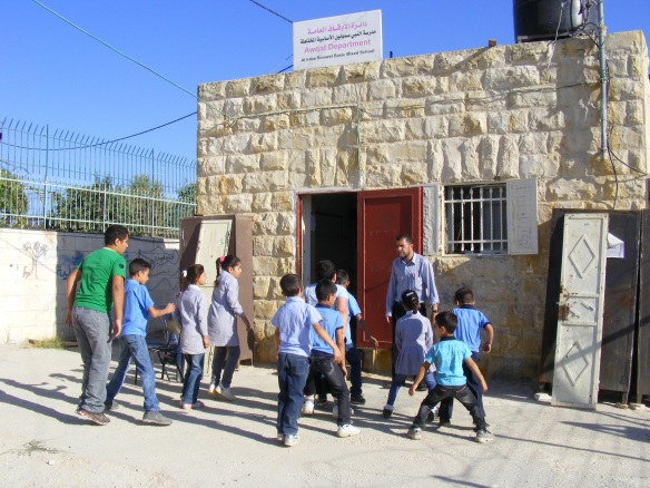 Children play in front of Nabi Samwil's one-room school. Photo EAPPI/K. Banks, 2012.