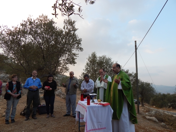 EAPPI observers attend the weekly Friday afternoon held by priests of Beit Jala to pray against the potential annexation of the Cremisan monestary and land belong to the people of Beit Jala by the seperation wall. Photo EAPPI/P. Fergus-Moore.