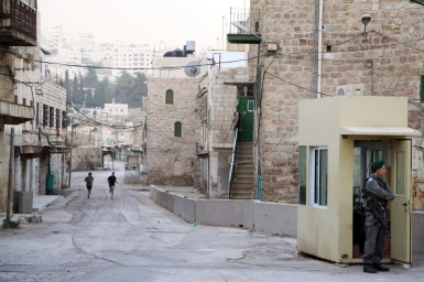 Israeli settlers jog on Shuhada street. Photo EAPPI/J. Schilder, 2010.