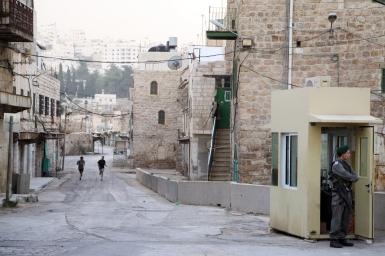 Israeli settlers jog on Shuhada street. Photo EAPPI/J. Schilder, 2010.