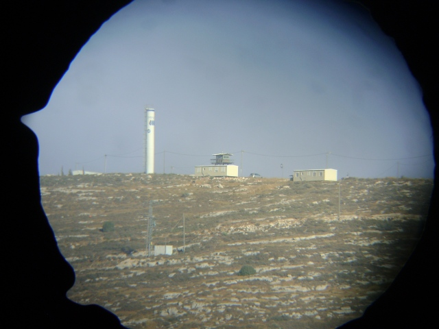 Outpost Hill 777 through binoculars. Photo EAPPI/C. Schelbert, 2012.