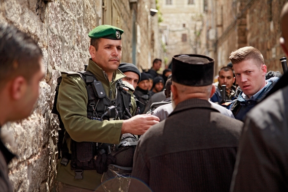 Israeli soldiers set up a flying checkpoint in the Old City of Jerusalem on Friday. They check the IDs of Palestinians before granting access to pray at Al Aqsa mosque. Photo EAPPI/K. Ranta.