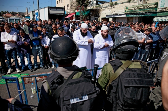 Worshippers pray outside an Israeli military flying checkpoint in the Old City streets when not allowed access to pray at Al Aqsa mosque. Photo EAPPI/K. Ranta.