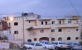The Rajabi building is located in Wadi al Hussein and also between the Kiryat Arba settlement and the old city of Hebron. Photo EAPPI/M. Prisco.