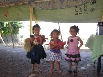 Three girls in Arab ar Ramadin visit the medical clinic. Photo EAPPI/M. Schaffluetzel.