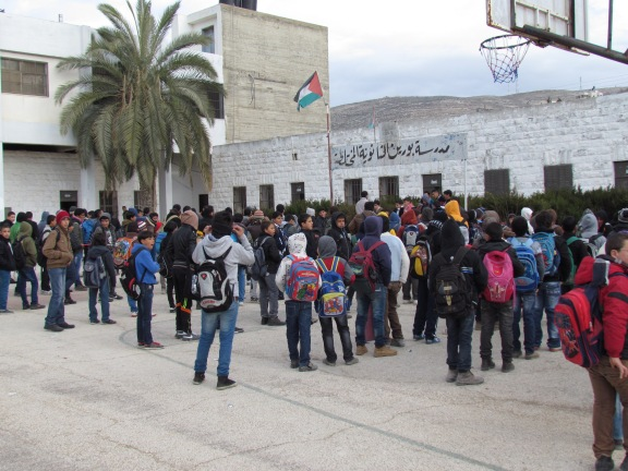 In Burin, the school begins with the national anthem as in all Palestinian schools. Photo EAPPI/T. Kopra.