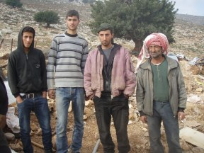 Fayas el Hammad and his sons after the demolition of their home in Khirbet Yarza. Photo EAPPI/K. Hodgson.