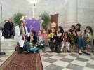 Pastor Mitri Raheb talks to children about Palm Sunday at Christmas Lutheran Church-Bethlehem. Photo EAPPI/M. Whitton.