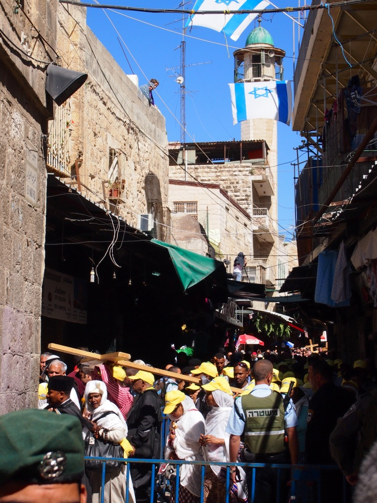 Pilgrims carry crosses as they travel the path of the Via Dolorosa on Good Friday. Israeli soldiers set up barriers throughout the Old City. Photo EAPPI/J. Kaprio.
