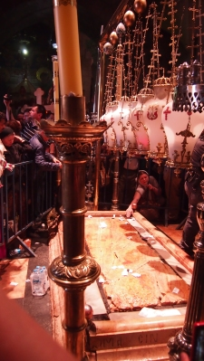 Women pray inside the Holy Sepulchre on Good Friday. Photo EAPPI/J. Valkama.