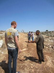 A Canadian EA listens as a farmer describes the destruction of his olive trees by Israeli settlers. Photo EAPPI/J. Fraser.