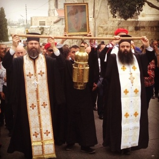 Priests carry the Holy Fire during the Holy Saturday procession in Beit Jala. Photo EAPPI/L. Hilton,