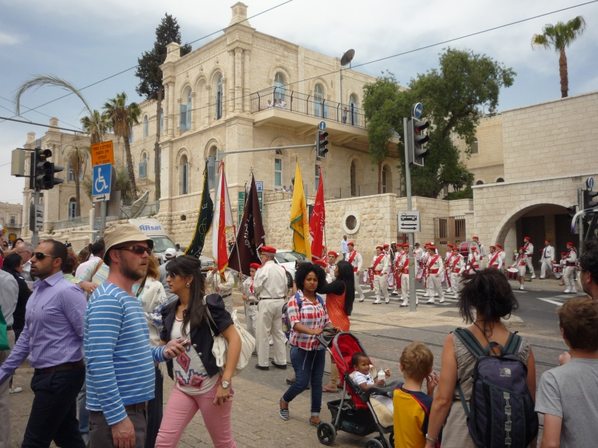 Many local Christians carried crosses as they processed the Via Dolorosa. Photo EAPPI/J. Valkama.