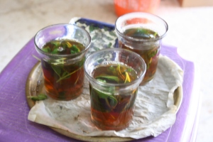Black tea with sugar and mint is a staple of Palestinian hospitality.