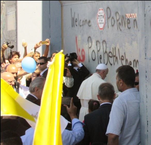 The Pope steps down from his vehicle to say a prayer at the separation wall in Bethlehem. Photo EAPPI/E. Mutschler.