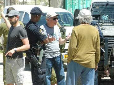 A member of Combatants for Peace negotiates for Hassan's release. Photo EAPPI/L. Hilton.