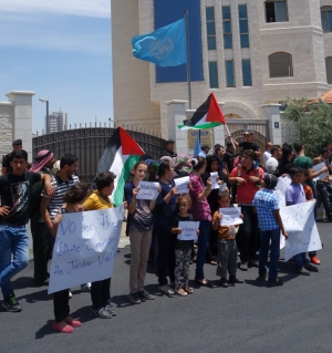 Children holding up the names of the demolished village in the Jordan valley. Photo EAPPI/S. Spiller.