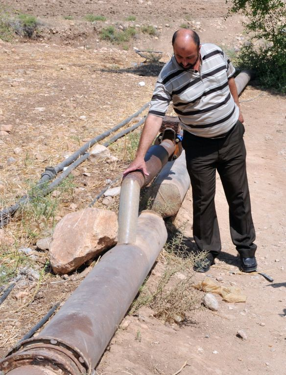Abu Dirra shows us the old larger Palestinian water pipe in Bardala which was severed.  Israeli authorities joined the smaller water pipe, allowing a smaller amount of water to be pumped to the village. Photo EAPPI/B. Saltnes.