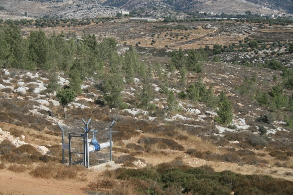 There is already water infrastructure on the land to be confiscated for future building of Israeli settlements. Photo EAPPI.