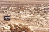 One of 3 Israeli army jeeps drives towards Tawayel, 10 September 2014. Photo EAPPI/N. Ray.