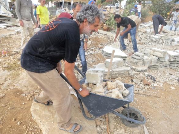 Eyal Shani rebuilding homes in um al kher.