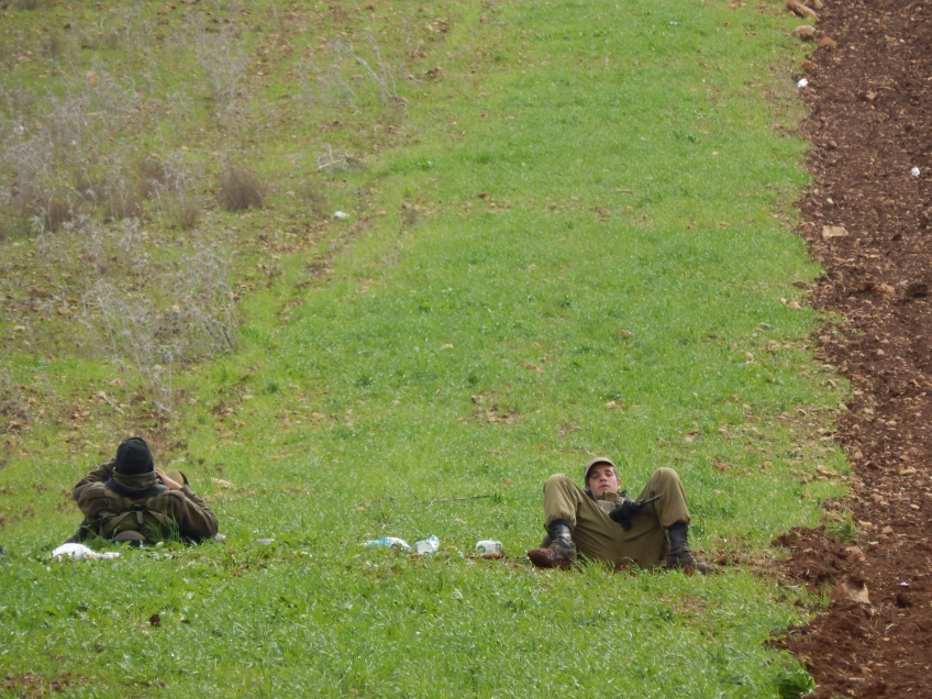 Soldiers lay down while outside As Sawiya School. - B. Viney-Wood