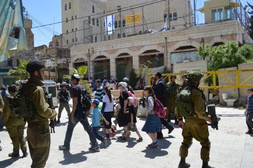 Photo EAPPI/ M. Guntern Settlers entering into the old city.  06.04.2015