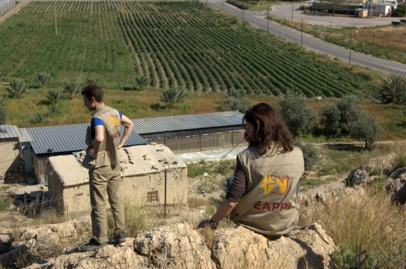 EAs Peter and Pia overlooking the Palestinian village of Marj e-Ghazal in the Jordan Valley.Photo EAPPI/M. Stacke