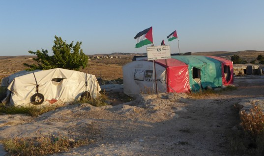 13/05/15. South Hebron Hills. Flags are fluttering in the village of Susiya, Photo EAPPI/P. Moore