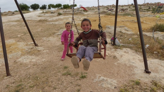 13/05/15. South Hebron Hills. Children play on swings in the village of Susiya, Photo EAPPI/P. Moore