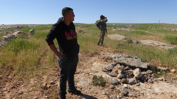 Nasser Nawaja discussing the land use in Yatta area with an ISF- soldier. South Hebron Hills  Photo EAPPI/P Moore