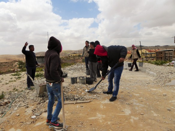 EAs help carry rubble from site of demolished house in Land Action in Um al Khair, South Hebron Hills  Photo EAPPI/P Moore 2015