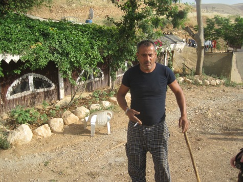 120515 Jordan Valley. Furush Beit Dajan. Tariq Abu Oum outside his home. Photo by EA Hughes