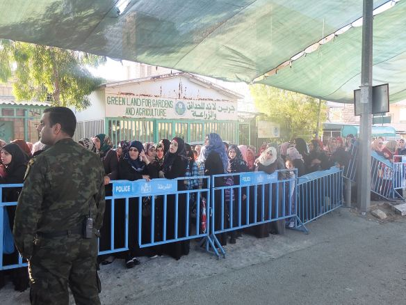 03.07.15. Bethlehem. Checkpoint 300 during third Friday of Ramadan. Women waiting. Photo EAPPI