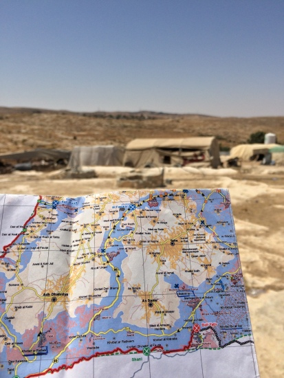01.07.15 Susiya -  Ever changing map of Southern West Bank and Susiya village in the background. Photo EAPPI /  A. Forsberg