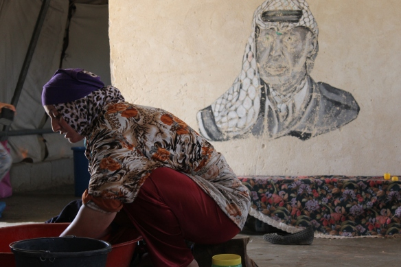 28.6.2015 Susiya, Resident of Susiya preparing a meal in her tent, Photo EAPPI / L. Pianezza