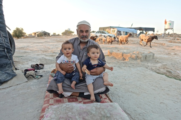 02.07.15 Susiya. Abu Jihad with his grandchildren, July 2015, photo EAPPI by L. Magne Helgesen
