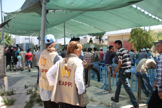 19.06.15. Bethlehem. Checkpoint 300 during the first Friday of Ramadan. EAs monitoring men's line. Photo EAPPI / I. Tanner