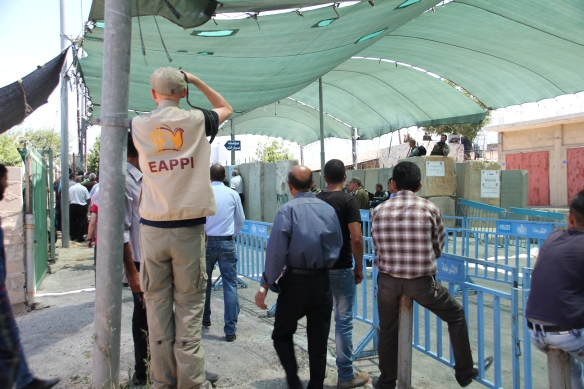 19.06.15. Bethlehem. Checkpoint 300 during the first Friday of Ramadan. EA monitoring men's line. Photo EAPPI / I. Tanner